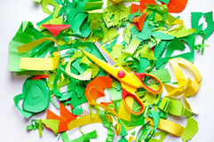 Pieces of colored paper and scissors Stock Photography