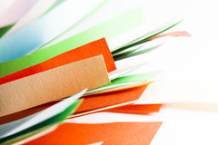 Pieces of colored paper on white background Royalty Free Stock Photo