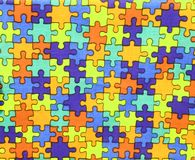 Pieces of colored puzzle on cotton fabric Stock Image