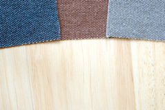 Pieces of colorful canvas on wood. Royalty Free Stock Photos