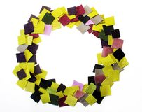 Pieces of colorful fabric lined in a circle. A variety of fabrics cut into squares, laid out in a circle, the predominance of green and violet flowers Stock Image