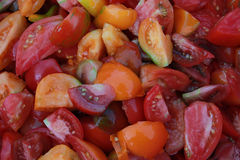 Pieces of colorful tomatoes. Pieces of red yellow orange striped tomato. Salad Stock Photography