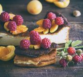 Pieces of cottage cheese pie with strawberries and apricots Royalty Free Stock Photography