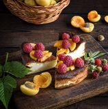 Pieces of cottage cheese pie with strawberries and apricots Stock Photos