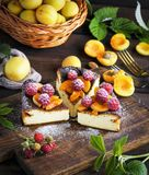 Pieces of cottage cheese pie with strawberries and apricots Royalty Free Stock Photos