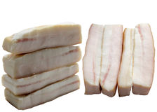 Pieces of crude fat of pork are isolated on a white background. Stock Photography