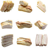 Pieces of crude fat of pork are isolated on a white background. Stock Image