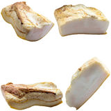 Pieces of crude fat of pork are isolated on a white background. Stock Photos