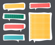 Pieces of cut colorful lined notebook paper on white speech bubbles Stock Images