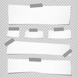 Pieces of cut white note paper are stuck with striped sticky tape on grid pattern Stock Images