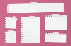 Pieces of cutout white ruled notebook paper are stuck with sticky tape on red background Royalty Free Stock Photo