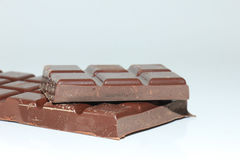 Pieces of a dark chocolate bar Royalty Free Stock Images
