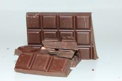 Pieces of a dark chocolate bar Stock Photos