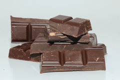 Pieces of a dark chocolate bar Royalty Free Stock Image