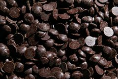 Pieces of dark chocolate. Bits and pieces of dark chocolate closeup Stock Images