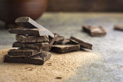 Pieces of dark chocolate stacked Royalty Free Stock Images