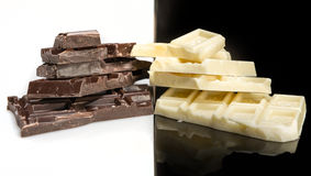 Pieces of dark and white chocolate Stock Image