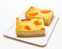 Pieces of delicious homemade Apricots cheesecake Stock Photo