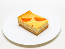 Pieces of delicious homemade Apricots cheesecake Stock Photography