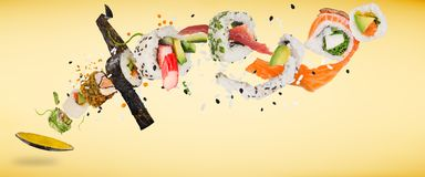 Pieces of delicious japanese sushi frozen in the air. Royalty Free Stock Images