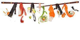 Pieces of delicious japanese sushi frozen in the air. Stock Photography