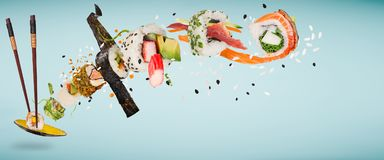 Pieces of delicious japanese sushi frozen in the air. Pieces of delicious japanese sushi frozen in the air on pastel color background stock image