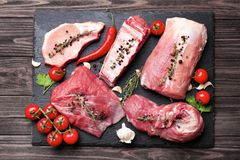 Pieces of different fresh meat Royalty Free Stock Images