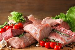 Pieces of different fresh meat. On kitchen table Royalty Free Stock Photography