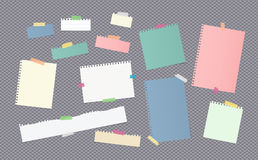 Pieces of different size colorful note, notebook, copybook paper sheets stuck with sticky tape on gray background Stock Images