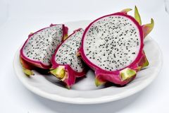 Pieces of dragon fruit on white plate royalty free stock photo
