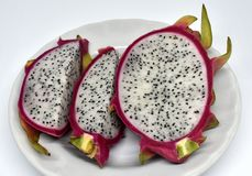 Pieces of dragon fruit on white plate royalty free stock images