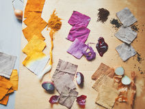 Pieces of dyed linen. Natural recources of pigments and dyed pieces of linen royalty free stock photography