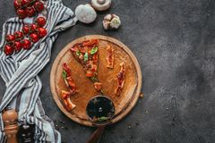 pieces of eaten pizza with cutter on concrete table Royalty Free Stock Images