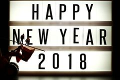 Pieces of english text spelling new year 2018 on illuminated light box. Pieces of english text spelling new year 2018 on illuminated light box in the scene Royalty Free Stock Photography