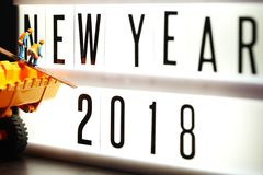 Pieces of english text spelling new year 2018 on illuminated light box. Pieces of english text spelling new year 2018 on illuminated light box in the scene Stock Photography