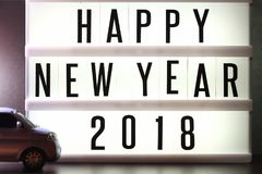 Pieces of english text spelling new year 2018 on illuminated light box. Pieces of english text spelling new year 2018 on illuminated light box in the scene Royalty Free Stock Photo