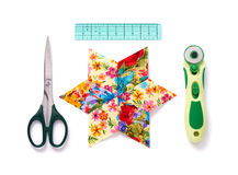 Pieces of fabric patchwork stitched in the shape of a star surro Royalty Free Stock Photos