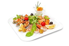 Pieces of fish fillet, fried and served on a white dish. Stock Image