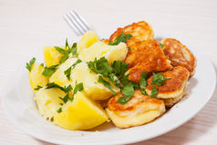 Pieces of fish fillets in batter with potato Royalty Free Stock Images