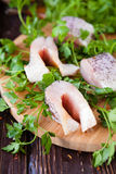 Pieces of fish fillets on a cutting board Stock Image