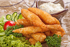 Pieces of fish fried in batter. Royalty Free Stock Photography
