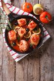 Pieces of fish in tomato sauce in a frying pan. vertical top vie Royalty Free Stock Photography