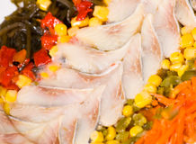 Pieces of fish with vegetables and seaweed Royalty Free Stock Photography