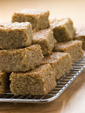 Pieces of Flapjack. On a cooling rack Stock Photo