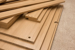 Pieces of flatpack furniture. Ready for assembly Stock Images