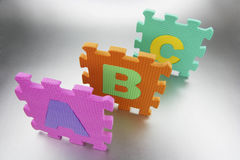 Pieces of Foam Alphabet Puzzle Mat Royalty Free Stock Image