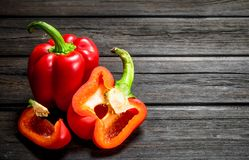 Pieces of fragrant sweet pepper. On wooden background royalty free stock image