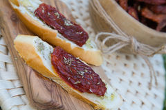 Pieces of french bread with dried tomatoes,oilve oil,and oregan Stock Photography