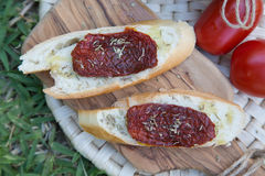 Pieces of french bread with dried tomatoes,oilve oil,and oregan Stock Photo
