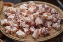 Pieces of fresh bacon on the plate. Stock Images